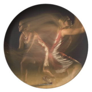 Double exposure of woman playing basketball plate