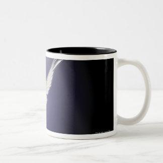 Dove flying through beam of light Two-Tone coffee mug