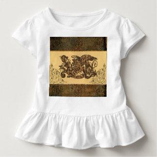 Dragon made of rusty metal w tee shirts