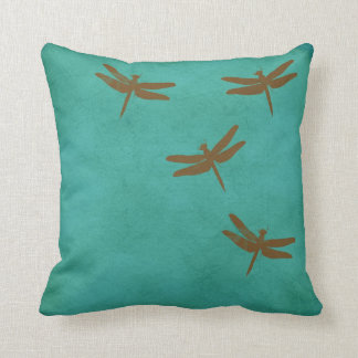 Dragonflies and teal colored pillow