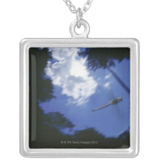Dragonfly in flight, flapping wings silver plated necklace