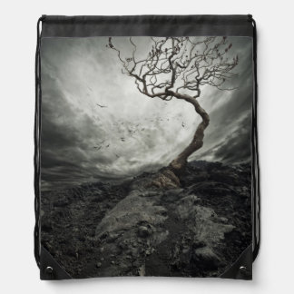 Dramatic sky over old lonely tree drawstring bag