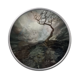 Dramatic sky over old lonely tree jelly belly tin