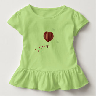 Dress of girl with globe in the form of heart