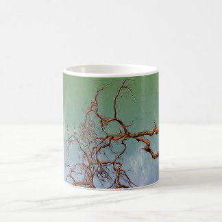 Dried tree branches on a coffee mug
