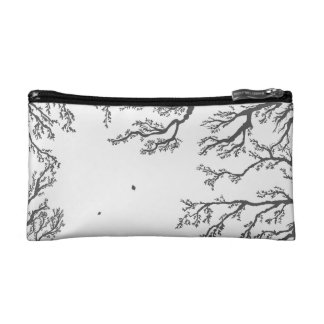 dried tree branches with birds and leaves on a lig cosmetic bags