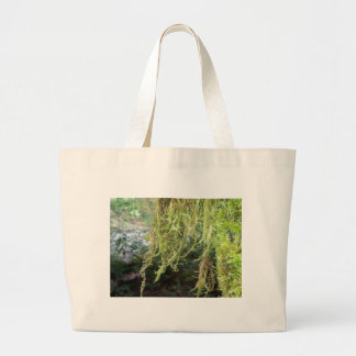 dripping vines along the river canvas bag