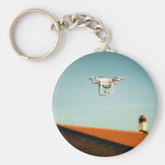 Dron above roofs basic round button key ring