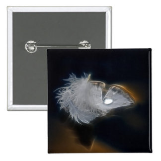 Droplet of water on a white feather pinback button