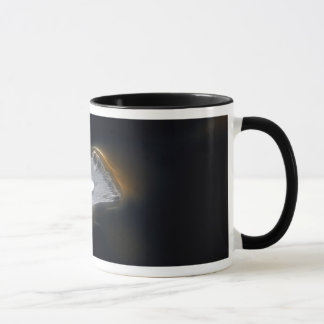 Droplet of water on a white feather mug