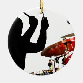 Drummer sticks in air shadow real drums round ceramic decoration