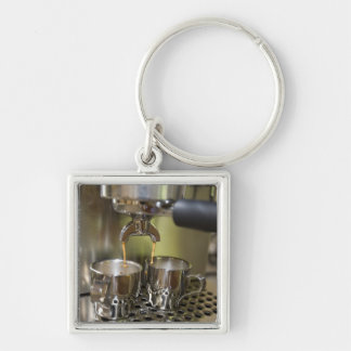 Dual espresso shots being brewed. Silver-Colored square key ring
