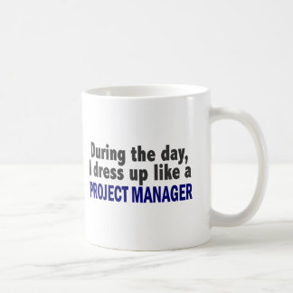 During The Day I Dress Up Like A Project Manager Basic White Mug