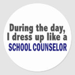 During The Day I Dress Up Like A School Counsellor Round Sticker