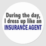 During The Day I Dress Up Like An Insurance Agent Round Sticker
