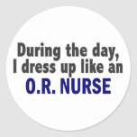 During The Day I Dress Up Like An O.R. Nurse Round Stickers