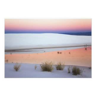 Dusk sky reflected in pool of water from photographic print