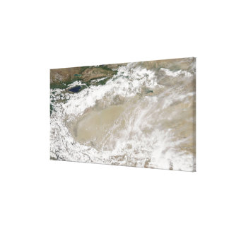 Dust and clouds hovered over the Taklimakan Des Canvas Print