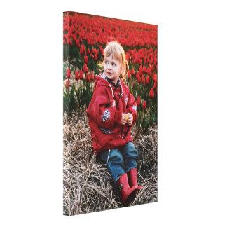 Dutch Girl in Red Tulip Field Canvas Print