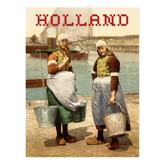 Dutch girls in traditional costume and clogs postcard