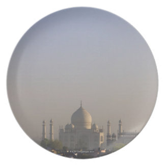 Early morning light on the dome of the Taj Mahal Plates