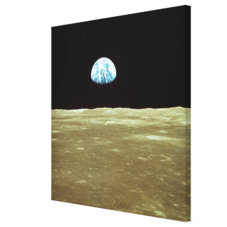 Earth rising over Moon Canvas Print