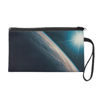 Earth Showing a Tropical Storm Wristlet Purses