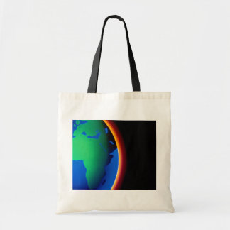Earth with glowing atmosphere tote bags