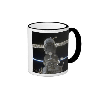 Earth's limb intersects a Soyuz spacecraft Mugs