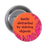 Easily distracted joke pinback buttons