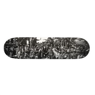 East and West Shaking Hands at Laying Last Rail Skateboard