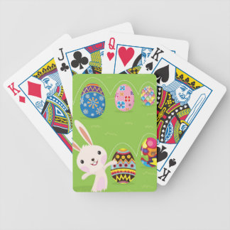 Easter bunny playful with painted eggs bicycle playing cards