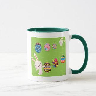 Easter bunny playful with painted eggs mug