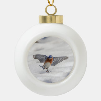 Eastern Bluebird dancing in the snow Ceramic Ball Decoration