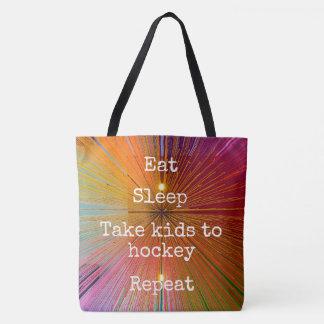 """Eat Sleep Repeat, Hockey"" quote orange tote bag"