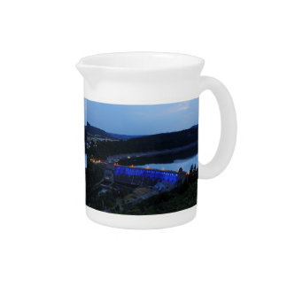 Edersee lit up concrete dam in the evening beverage pitchers