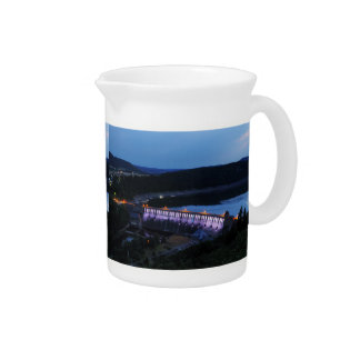 Edersee lit up concrete dam in the evening drink pitcher