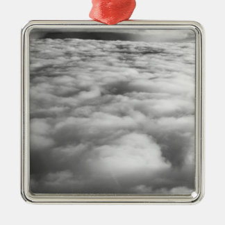 Eerie cloudscape at sunrise. Silver-Colored square decoration