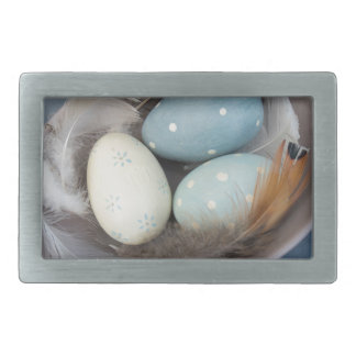 Eggs and feathers belt buckles