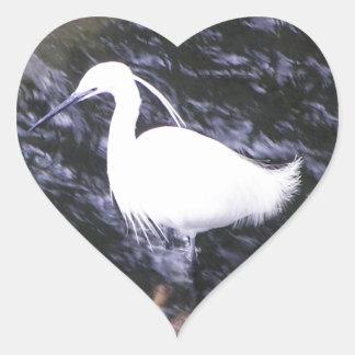 Egret in fast flowing river heart sticker