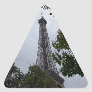Eiffel Tower view between foliage Triangle Sticker