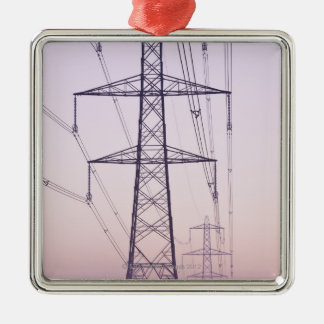 Electricity pylons in mist at dawn. christmas ornament