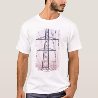 Electricity pylons in mist at dawn. T-Shirt
