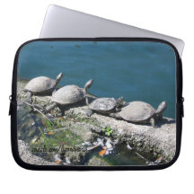 Electronics bag featuring family of turtles laptop sleeve