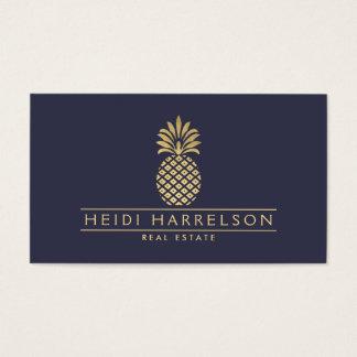 Elegant Golden Pineapple Logo on Dusky Blue