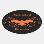 Elegant gothic victorian bat in orange on black oval sticker