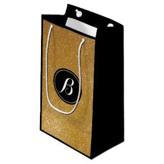 Elegant luxury gold glitter monogram gift bag