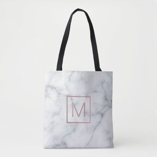 elegant rose gold monogram on white marble stone
