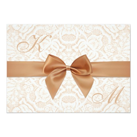 Elegant wedding invitation with ribbon and lace