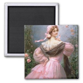Elegant woman in a rose garden square magnet